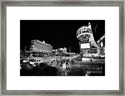 Las Vegas Boulevard Outside The Bellagio And Paris At Night Nevada Usa Framed Print by Joe Fox