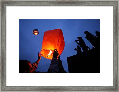 Launching Wish Lanterns Framed Print by Science Photo Library