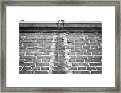 Leaking Gutter Framed Print by Tom Gowanlock