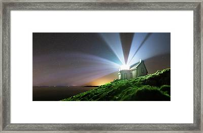 Lighthouse Beams At Night Framed Print by Laurent Laveder