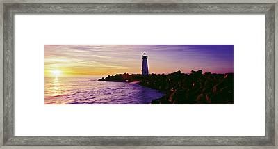 Lighthouse On The Coast At Dusk, Walton Framed Print