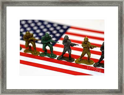 Line Of Toy Soldiers On American Flag Shallow Depth Of Field Framed Print
