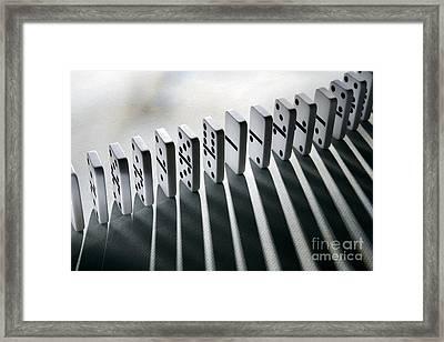 Lined Up Dominoes Framed Print by Victor de Schwanberg