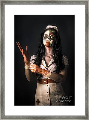 Living Dead Health Professional Putting On Gloves Framed Print by Jorgo Photography - Wall Art Gallery
