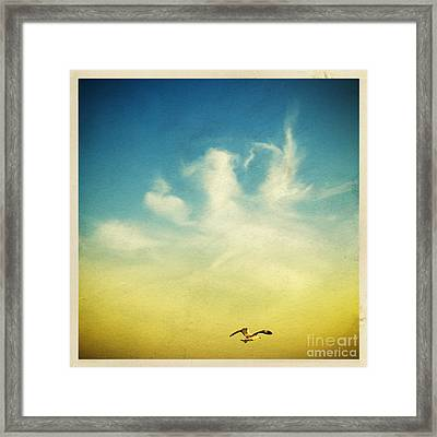Lonely Seagull Framed Print by Setsiri Silapasuwanchai