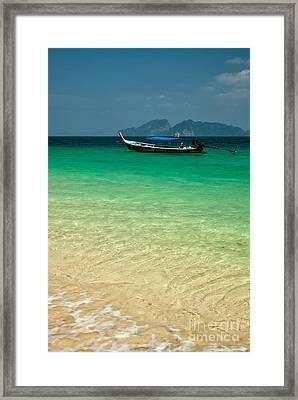 Longboat Asia Framed Print by Adrian Evans