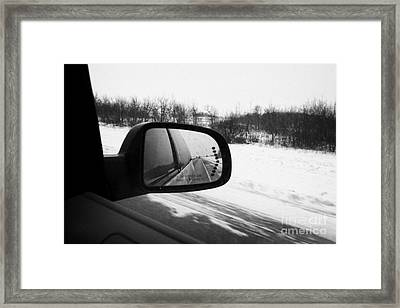 looking at side view mirror winter driving along Saskatchewan highway 11 from Saskatoon to Regina Ca Framed Print by Joe Fox