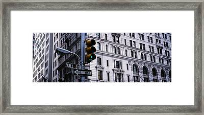 Low Angle View Of A Traffic Light Framed Print