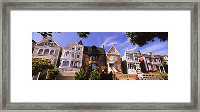 Low Angle View Of Houses In A Row Framed Print
