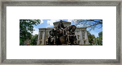 Low Angle View Of Statue Framed Print by Panoramic Images
