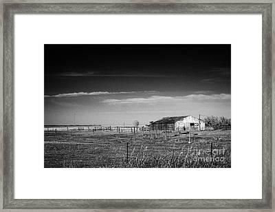low wooden barn on farm in rural Canada Framed Print by Joe Fox