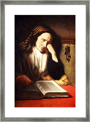 Mae's An Old Woman Dozing Over A Book Framed Print