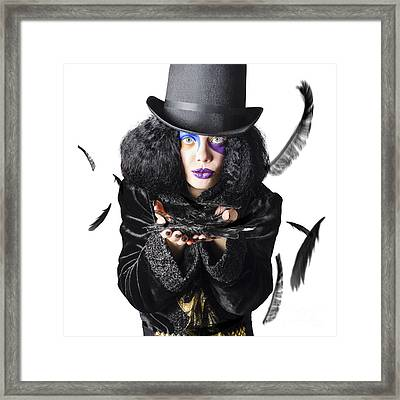 Magician Blowing Feathers Framed Print by Jorgo Photography - Wall Art Gallery