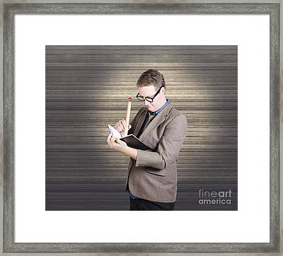 Male Administration Clerk Writing Diary Notes Framed Print