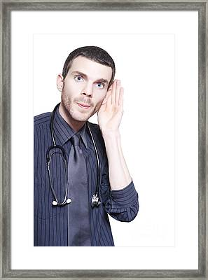 Male Audiologist Doctor Listening To Patient Framed Print by Jorgo Photography - Wall Art Gallery