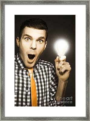 Male Business Person With Light Bulb In Hand Framed Print by Jorgo Photography - Wall Art Gallery