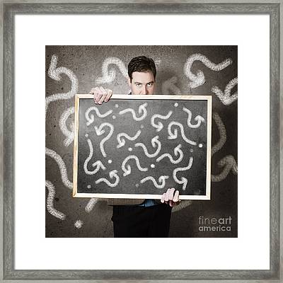 Man Holding Direction Sign With Arrow Questions Framed Print