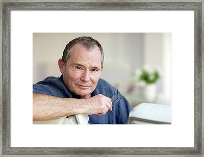 Man Holding His Glasses Framed Print by Ian Hooton/science Photo Library