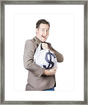 Man Holding Large Sum Of Money In Bank Deposit Bag Framed Print by Jorgo Photography - Wall Art Gallery