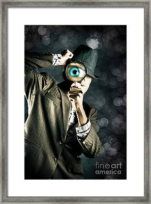 Man Looking Through Magnifying Glass Framed Print