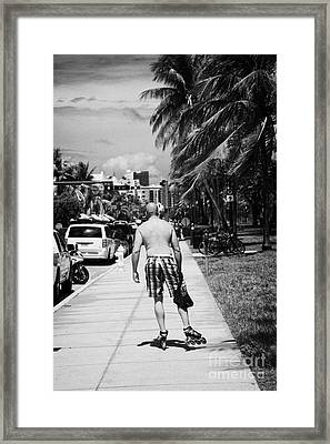 Man Rollerblading Along Ocean Drive Early Morning Art Deco District Miami South Beach Florida Usa Framed Print by Joe Fox