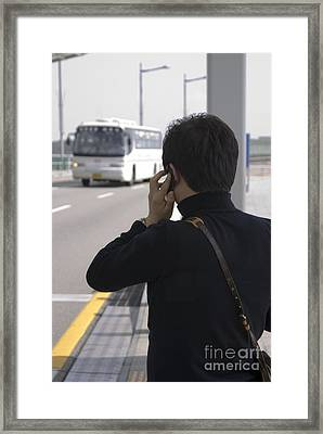 Man Using Mobile Phone Framed Print