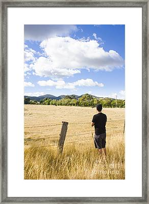 Man Watching Cattle On An Australian Country Farm Framed Print by Jorgo Photography - Wall Art Gallery
