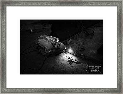 man welding metal plates together on the street Las Vegas Nevada USA Framed Print