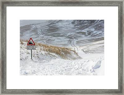 Massive Snow Drifts Blocking A Road Framed Print by Ashley Cooper