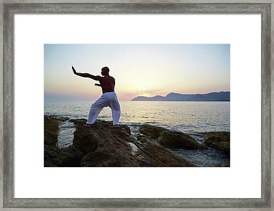 Mature Man Doing Tai Chi Framed Print