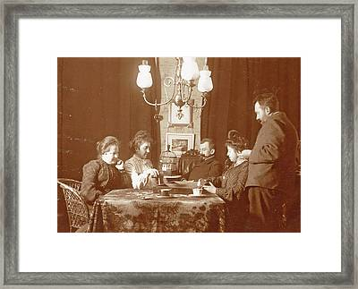 Men And Women Playing A Board Game In A Living Room Framed Print by Artokoloro