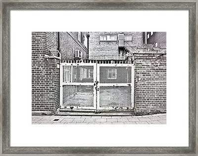 Metal Gate Framed Print by Tom Gowanlock