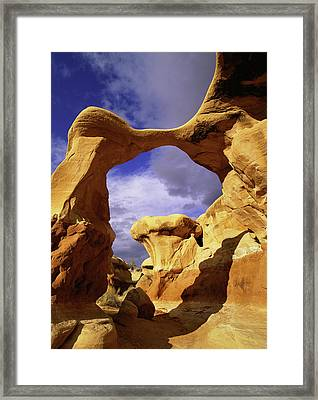 Metate Arch Stands Guard In Devil's Framed Print by Jerry Ginsberg