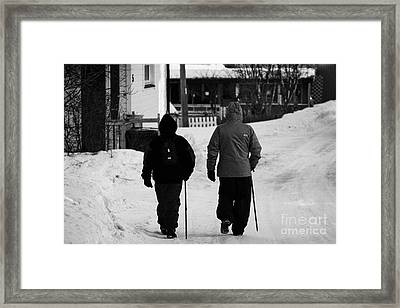 Middle Aged Couple Walking Along Snow Covered Street With Sticks Kirkenes Finnmark Norway Europe Framed Print