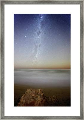 Milky Way Over Coastal Waters Framed Print by Luis Argerich