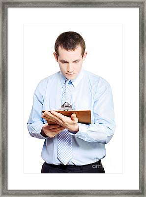 Minute Taking Businessman Reading Meeting Notes Framed Print