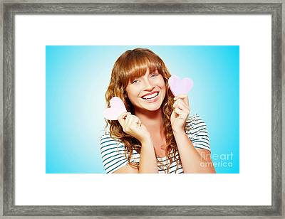 Mischievous Valentine Girl Holding Two Love Hearts Framed Print