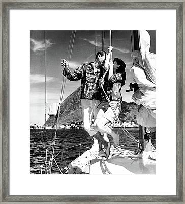 Models Wearing A Bennett Shirts On A Sailboat Framed Print by Richard Waite