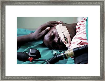 Monitoring A Patient's Heart Rate Framed Print by Mauro Fermariello/science Photo Library