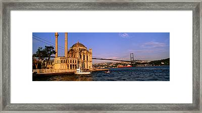 Mosque At The Waterfront Near A Bridge Framed Print by Panoramic Images