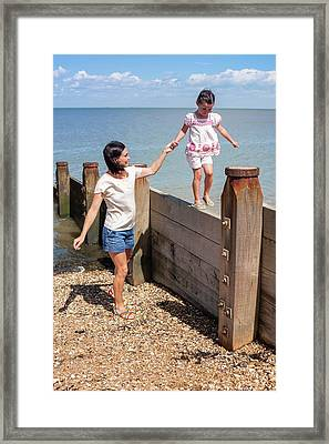 Mother And Daughter On Beach Framed Print