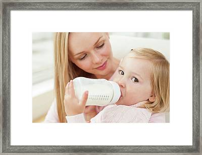 Mother And Daughter With A Bottle Framed Print