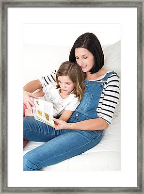 Mother Reading Book With Daughter Framed Print by Lea Paterson