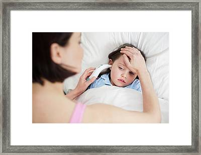 Mother Taking Daughter's Temperature Framed Print