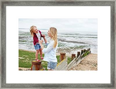 Mother With Daughter On Beach Framed Print