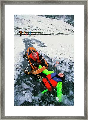 Mountain Rescue Team Framed Print by Ashley Cooper