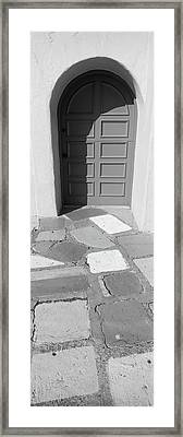 Multi-colored Tiles In Front Of A Door Framed Print