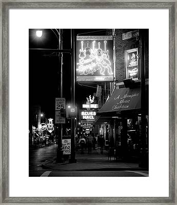 Neon Sign Lit Up At Night In A City Framed Print
