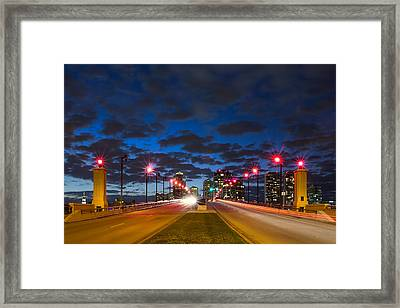 Night Lights Framed Print by Debra and Dave Vanderlaan