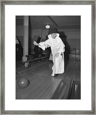 Nuns Bowling Framed Print by Underwood Archives
